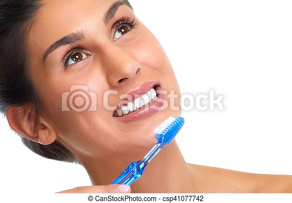 Smiling woman with toothbrush. - csp41077742