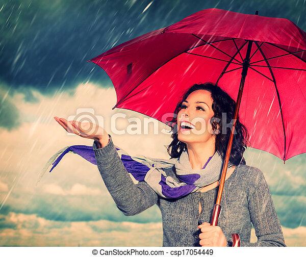 Smiling Woman with Umbrella over Autumn Rain Background - csp17054449