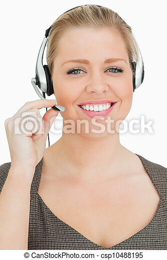 Smiling woman working in a call center - csp10488195
