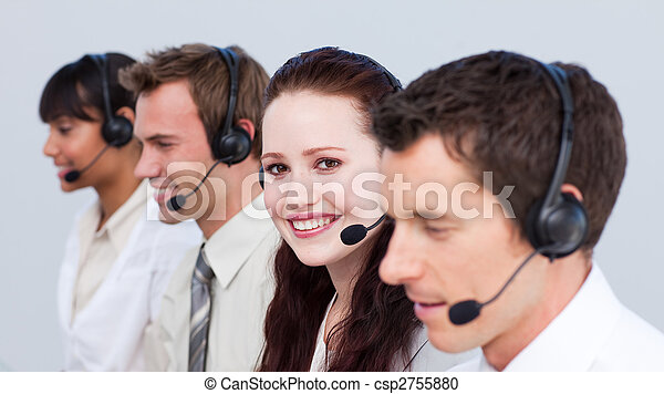 Smiling woman working in a call center with her colleagues - csp2755880