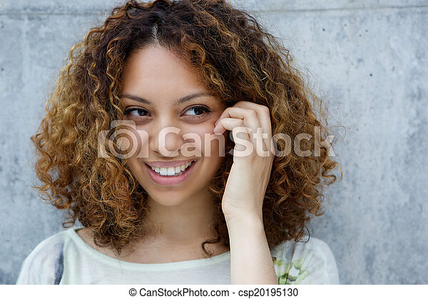 Smiling young african american woman - csp20195130