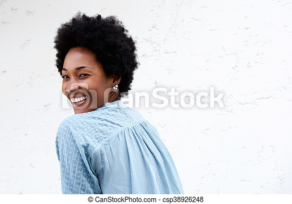 Smiling young african lady looking back - csp38926248