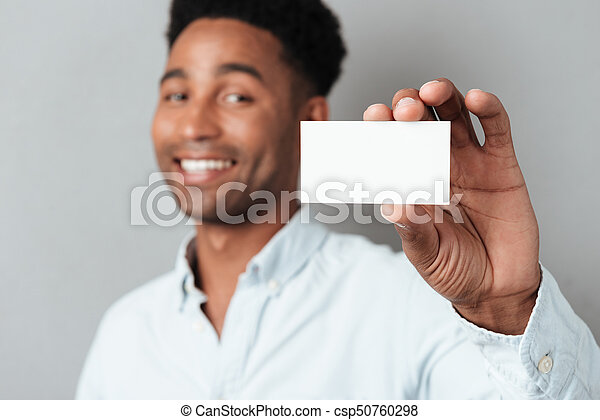 Smiling young afro american guy showing blank business card isolated smiling young afro american guy showing blank business card csp50760298 colourmoves
