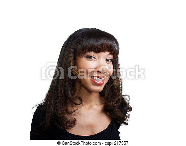 Smiling young black woman with braces on upper teeth - csp1217357