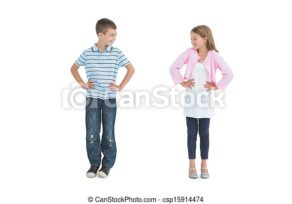 Smiling young brother and sister looking at each other - csp15914474