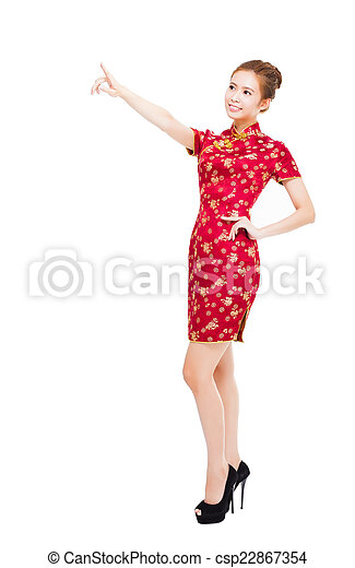 smiling young chinese woman pointing something - csp22867354