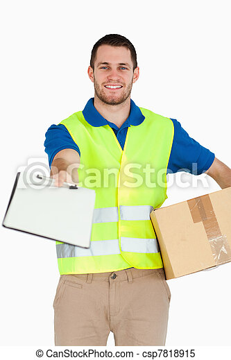 Smiling young delivery man with packet asking for signature - csp7818915