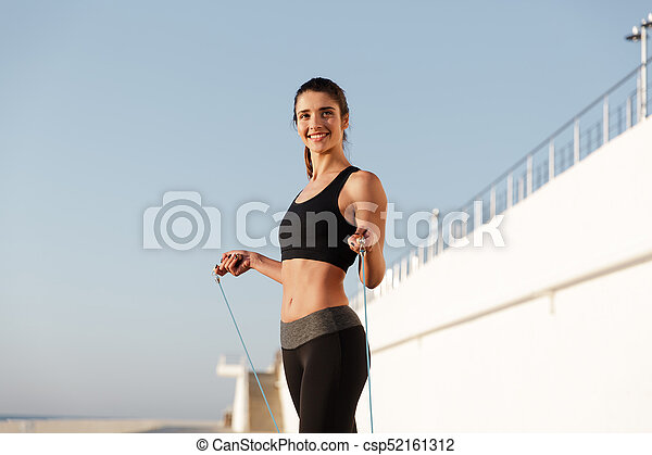 Smiling young happy sports woman make sport exercises - csp52161312
