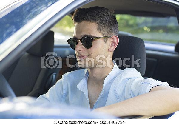 smiling young man in car - csp51407734