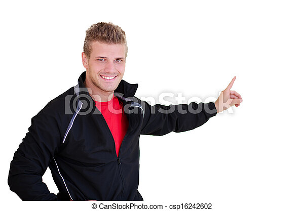 Smiling, young personal trainer pointing finger at blank space - csp16242602