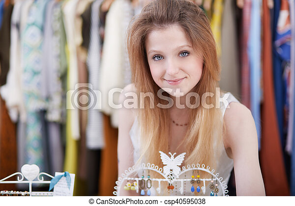 Smiling young woman holding dress - csp40595038