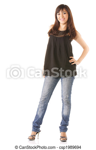 Smiling young woman in jeans - csp1989694