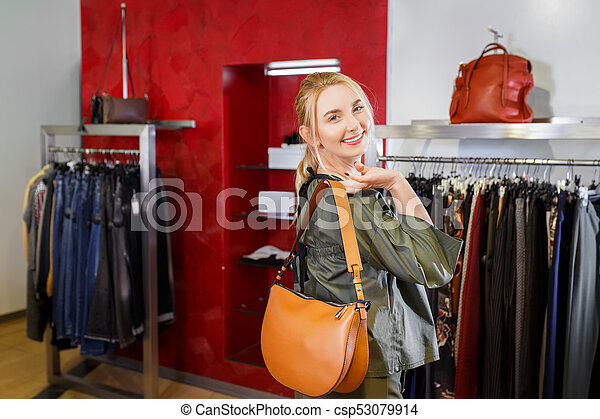 smiling young woman in the store - csp53079914