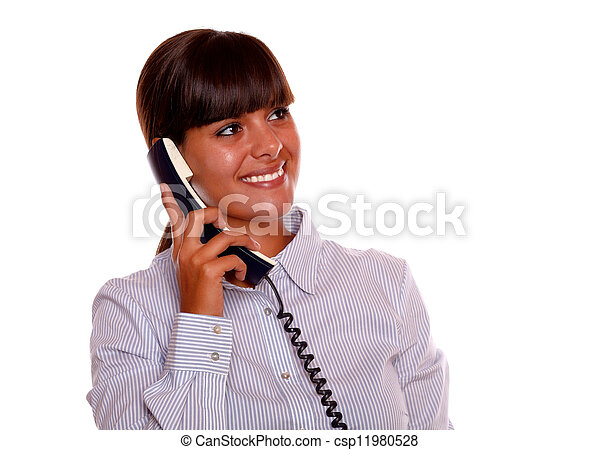 Smiling young woman looking left up with phone - csp11980528
