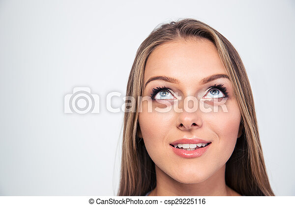 Smiling young woman looking up - csp29225116