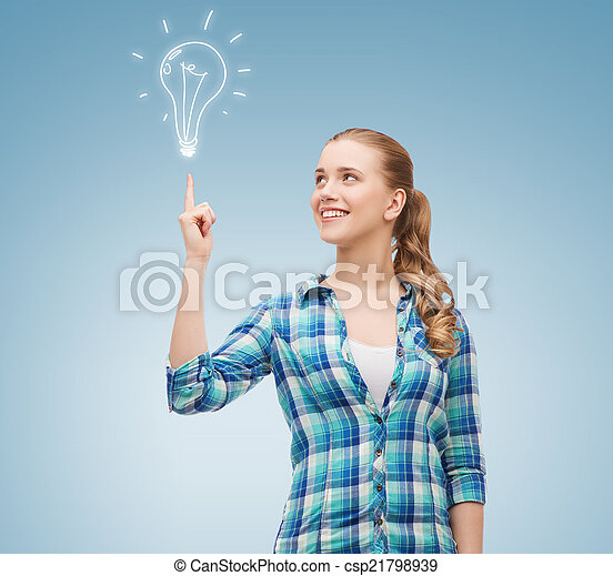smiling young woman pointing finger up - csp21798939