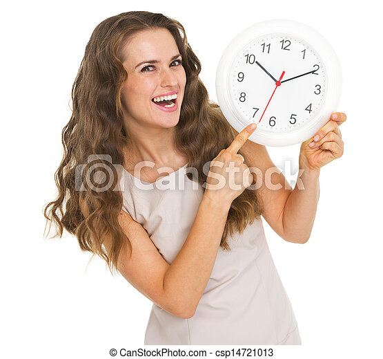 Smiling young woman pointing on clock - csp14721013