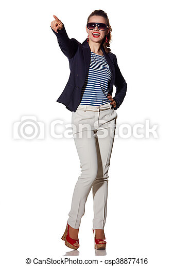 smiling young woman pointing on copy space on white background - csp38877416