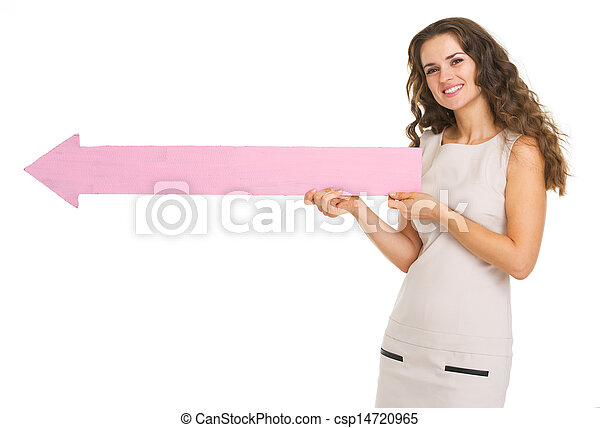 Smiling young woman pointing on copy space with arrow - csp14720965