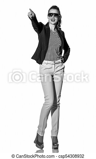 smiling young woman pointing on copy space on white background - csp54308932