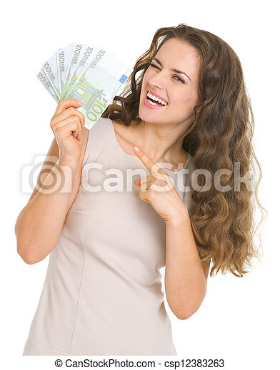 Smiling young woman pointing on euros - csp12383263