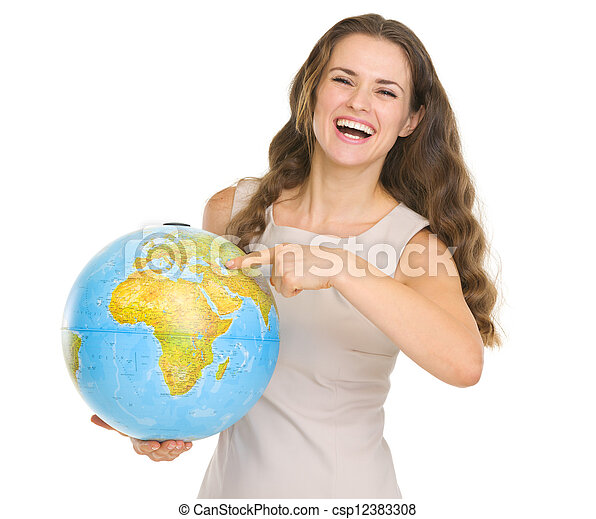 Smiling young woman pointing on globe - csp12383308