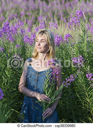 smiling young woman with bunch of w - csp38339980