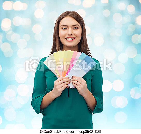 smiling young woman with color swatches - csp35021028