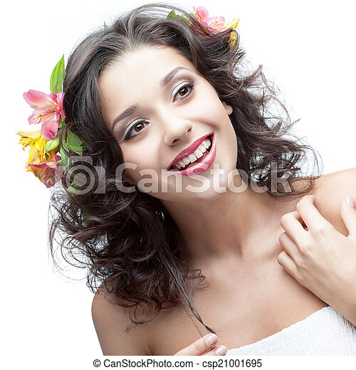smiling young woman with flower in hair - csp21001695