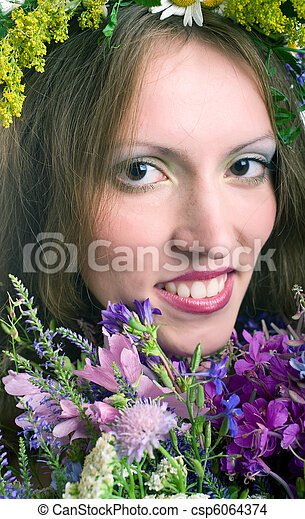 smiling young women with flowers - csp6064374