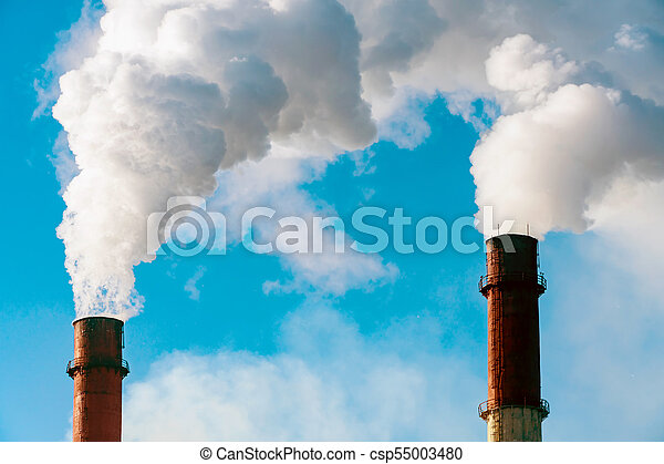 Smoke from factory pipes against blue sky - csp55003480