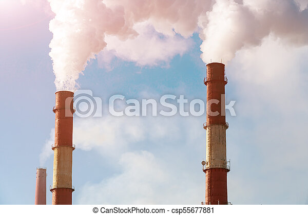 Smoke from factory pipes against blue sky - csp55677881
