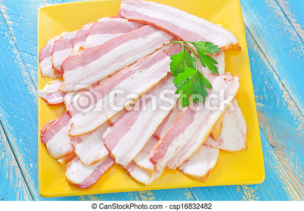 smoked bacon on plate - csp16832482