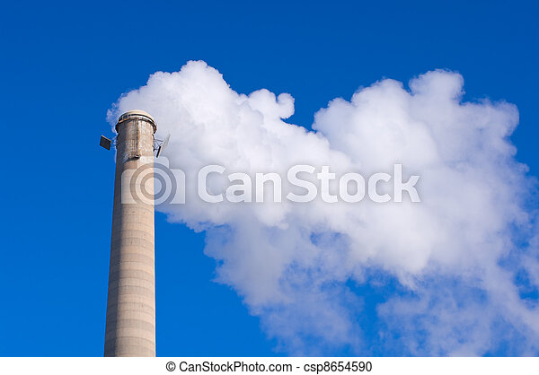 Smokestack and Gas Emissions Against Blue Sky - csp8654590