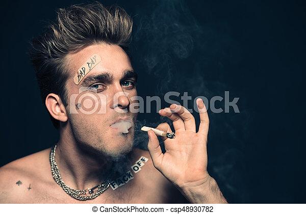 smoking addicted man - csp48930782