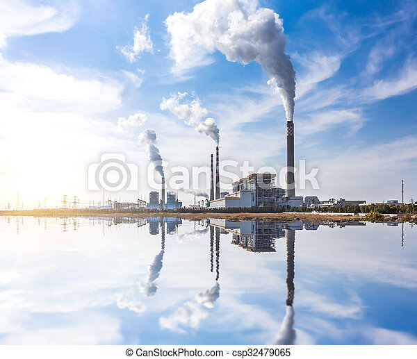Smoking pipes of thermal power plant against blue sky - csp32479065