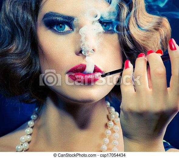 Smoking Retro Woman Portrait. Beauty Girl with Mouthpiece - csp17054434