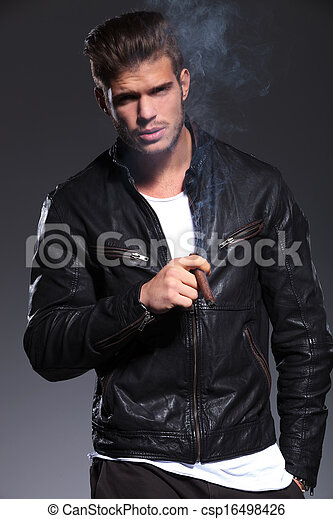Smoking Young Man In Leather Jacket Young Man In Leather Jacket Is