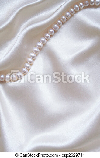 Smooth elegant white silk with pearls as wedding background - csp2629711