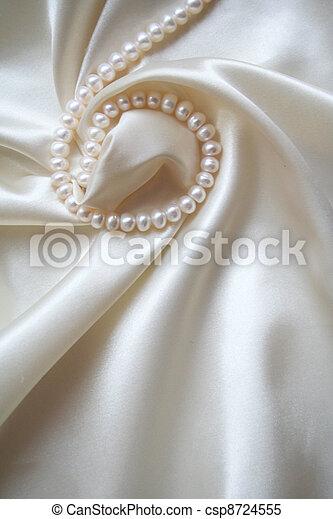 Smooth elegant white silk with pearls as wedding background - csp8724555