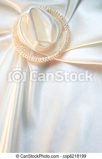 Smooth elegant white silk with pearls as wedding background  - csp6218199