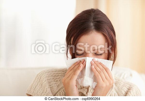 Sneezing cute woman - csp6990264