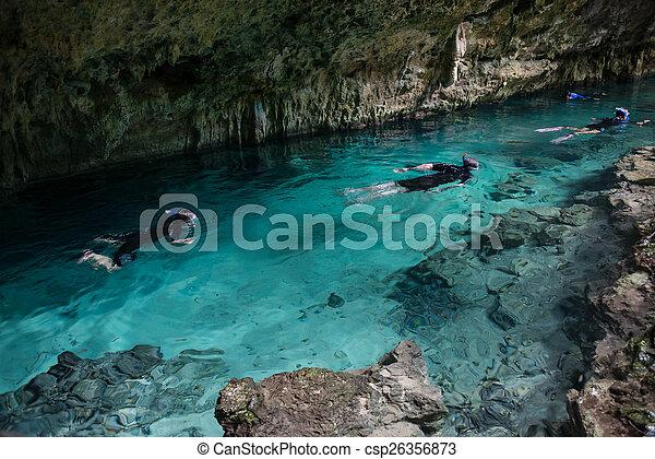 Snorkeling Cenote Pet Cementery, Tulum, Mexico. - csp26356873