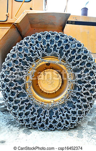 Snow chain on a truck's tyre - csp16452374