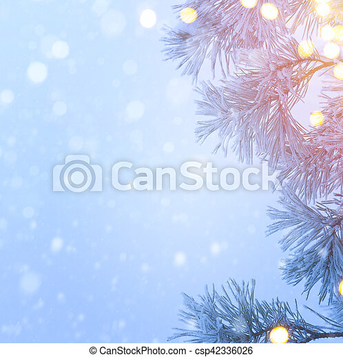 Snow Christmas Tree And Holidays Light Blue Background Real Winter