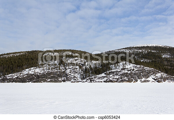Snow-covered rock - csp6053424