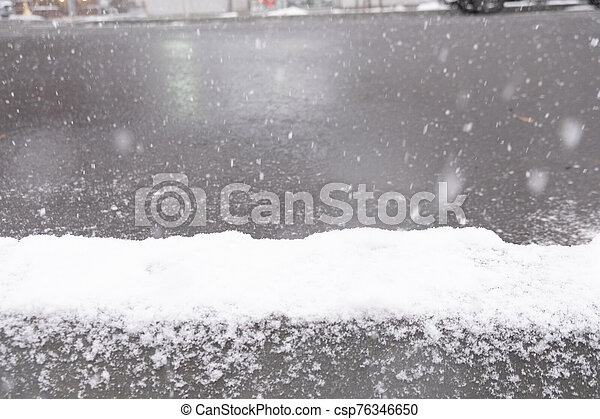 Snow covered sidewalk in Sapporo city - csp76346650