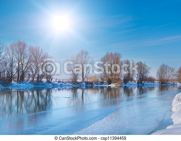 snow-covered winter river in sunny day - csp11394459