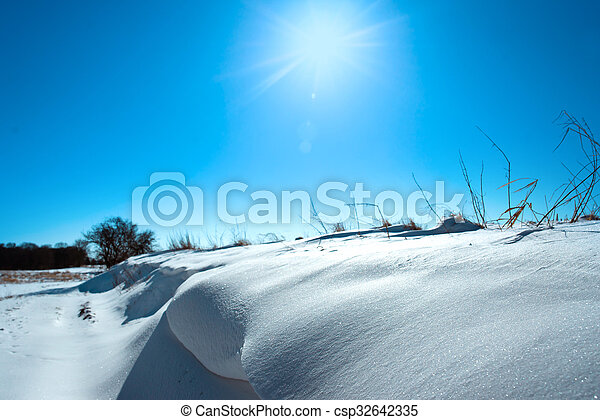 Snow in a winter landscape with sunshine - csp32642335
