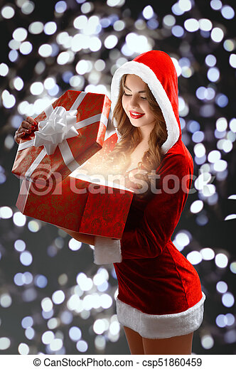Snow maiden in red suit holding a gift for new year 2018,2019 ...